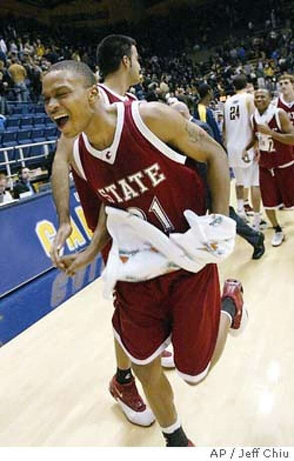 Washington State's Anthony Grant smiles with teammate Shami Gill, second from left, after Washington State beat California 55-50 in Berkeley, Calif. on Sunday, Jan. 4, 2004. (AP Photo/Jeff Chiu) Photo: JEFF CHIU