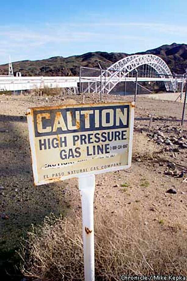 A rusty sign warns bypassers of the dangers near the El Paso natural gas pipelines in Topock, AZ that span across the Colorado River carrying natural gas to the California border. BY MIKE KEPKA/THE CHRONICLE Photo: MIKE KEPKA