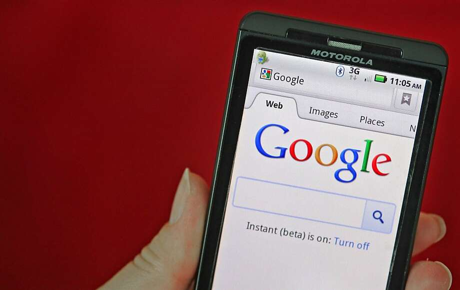 The Google Inc. homepage is seen on a Motorola Holdings Inc. mobile device, running on Google's Android software, in Park Ridge, Illinois, U.S., on Monday, Aug. 15, 2001. Google Inc., maker of the Android mobile-phone software, agreed to buy smartphone maker Motorola Mobility Holdings Inc. for $12.5 billion in its biggest deal, gaining mobile patents and expanding in the hardware business. Photographer: Tim Boyle/Bloomberg Photo: Tim Boyle, Bloomberg