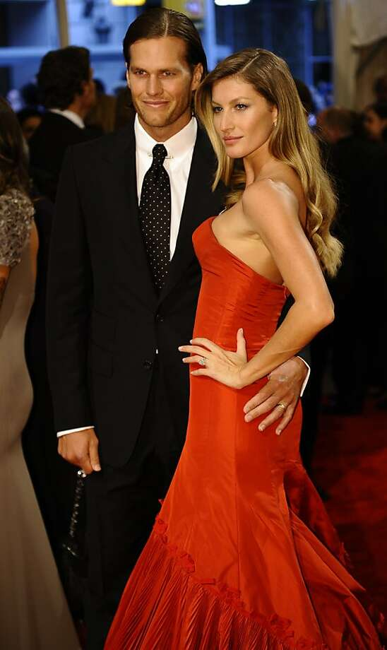 NFL player Tom Brady of the New England Patriots and model Gisele Bundchen attends the 'Alexander McQueen: Savage Beauty' Costume Institute Gala at The Metropolitan Museum of Art on May 2, 2011. AFP PHOTO / TIMOTHY A. CLARY (Photo credit should read TIMOTHY A. CLARY/AFP/Getty Images) Photo: Timothy A. Clary