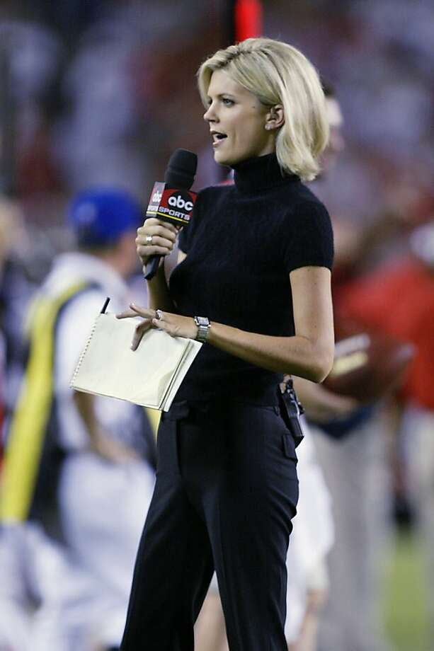 TAMPA, FL - SEPTEMBER 23:  Broadcaster Melissa Stark of ABC reports from the sideline during the NFL game between the St. Louis Rams and the Tampa Bay Buccaneers on September 23, 2002 at Raymond James Stadium in Tampa, Florida. The Buccaneers won 26-14. (Photo by Andy Lyons/Getty Images) Photo: Andy Lyons