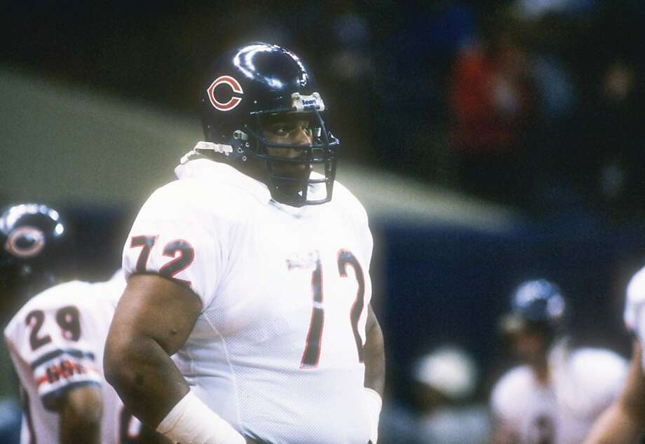 26  Jan 1986:  Defensive lineman William (Refrigerator) Perry of the Chicago Bears watches  from the side during the Super Bowl  XX  game with the New England Patriots at the Louisiana Superdome in New Orleans, Louisiana.  The Bears won the game, 46-10. Photo: Mike Powell