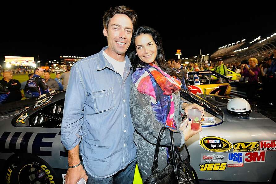 CHARLOTTE, NC - OCTOBER 15:  Actress Angie Harmon (R) and former NFL player Jason Sehorn (L) attend