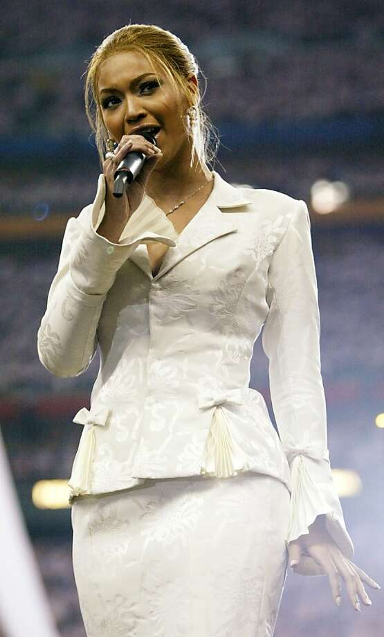 HOUSTON, TX - FEBRUARY 1:  Beyonce Knowles sings the National Anthem prior to the start of Super Bowl XXXVIII between the New England Patriots and the Carolina Panthers at Reliant Stadium on February 1, 2004 in Houston, Texas. (Photo by Frank Micelotta/Getty Images) Photo: Frank Micelotta