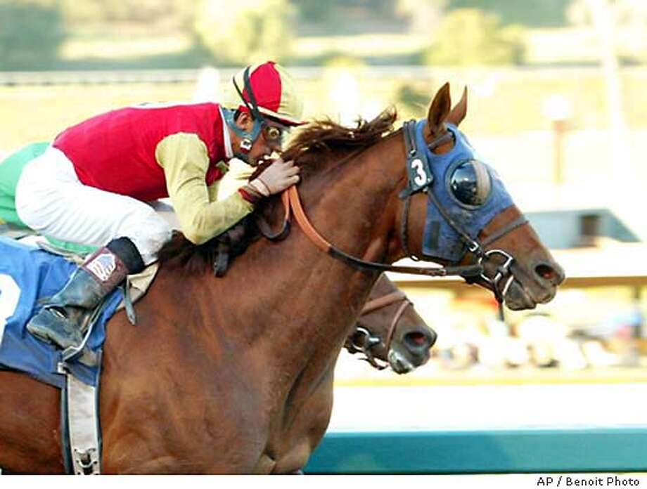 Star Cross (3), ridden by Victor Espinoza, wins the San Pasqual Handicap by a nose over Nose The Trade, ridden by Patrick Valenzuela, Saturday, Jan. 3, 2004, at Santa Anita Park in Arcadia, Calif. (AP Photo/Benoit Photo) BENOIT PHOTO