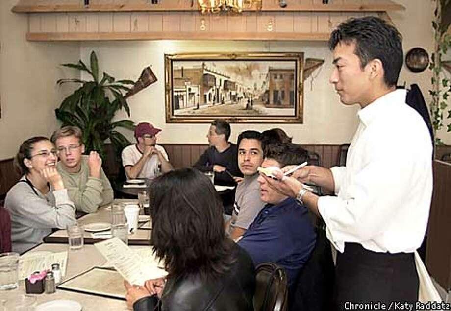 PHOTO BY KATY RADDATZ--THE CHRONICLE  Mi Lindo Peru is a restaurant review; restaurant is at 3226 Mission St. in San Francisco. SHOWN: Owner Carlos Miyahira waits tables. Photo: KATY RADDATZ