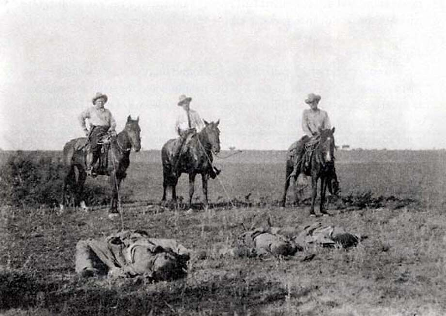 Texas Rangers pose with corpses after Sedicioso raid on the Norias division of the King Ranch.