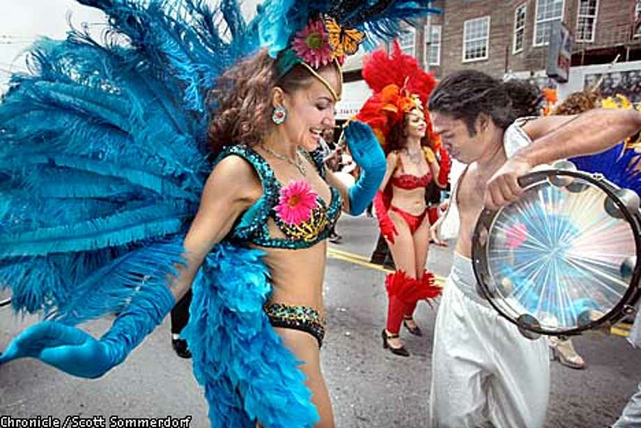 Marija Stefanac and Emiliano Benevides (both CQ) of Samba do Coracao (CQ) dance on Mission street during the 2002 San Francisco Carnaval Parade. (SF CHRONICLE PHOTO BY SCOTT SOMMERDORF) Photo: SCOTT SOMMERDORF
