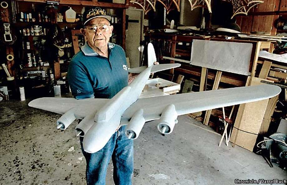 Delmer Sparrowe holds his wooden scale model that will be cast in bronze and mounted on a memorial in Australia. Chronicle photo by Darryl Bush