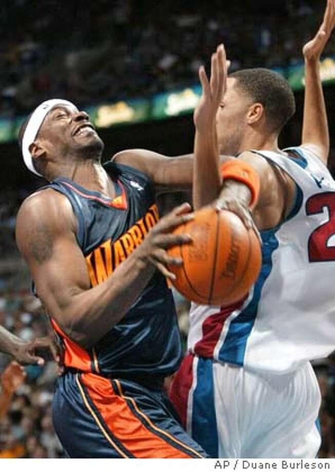 Golden State Warriors forward Clifford Robinson, left, tangles with Detroit Pistons forward Tayshaun Prince under the basket in the second quarter Saturday, Jan. 3, 2004, in Auburn Hills, Mich. Prince was whistled for a foul on the play. (AP Photo/Duane Burleson) Photo: DUANE BURLESON