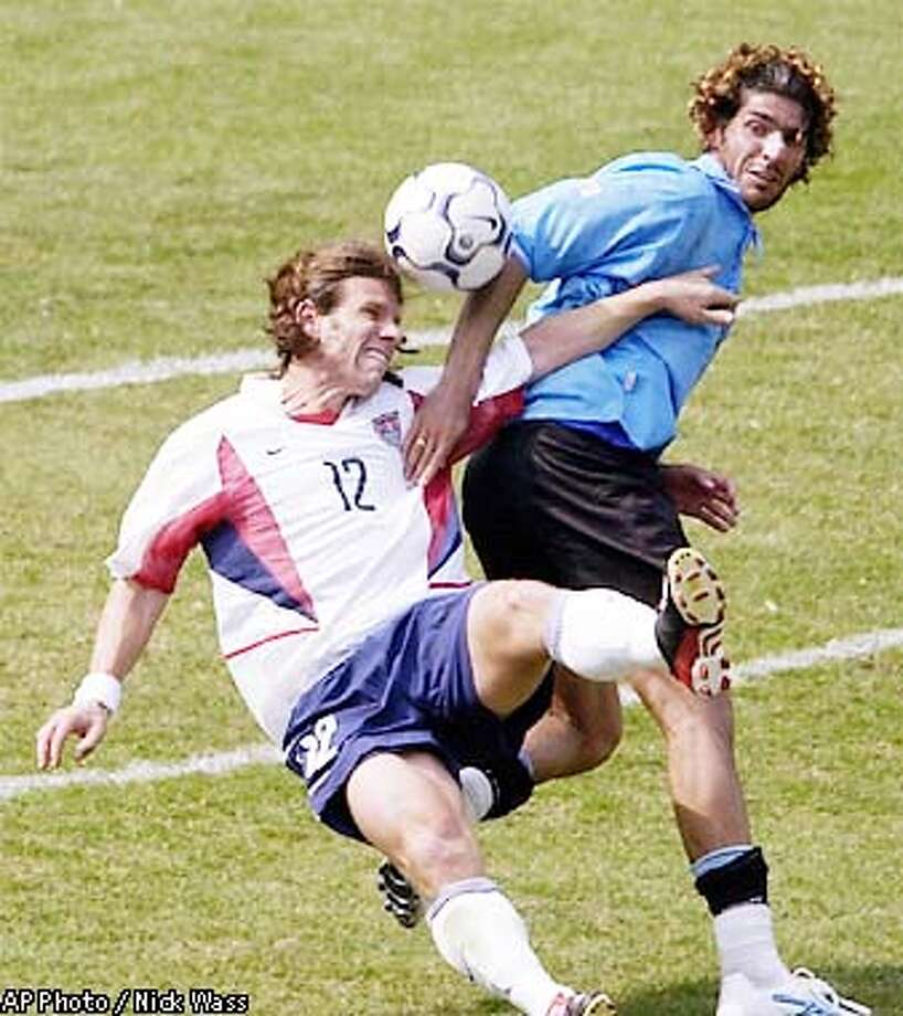 United States' Jeff Agoos (12) battles for the ball with Uruguay's Sebastian Abreu in the second half Sunday, May 12, 2002, in Washington. The United States won 2-1. (AP Photo/Nick Wass) Photo: NICK WASS