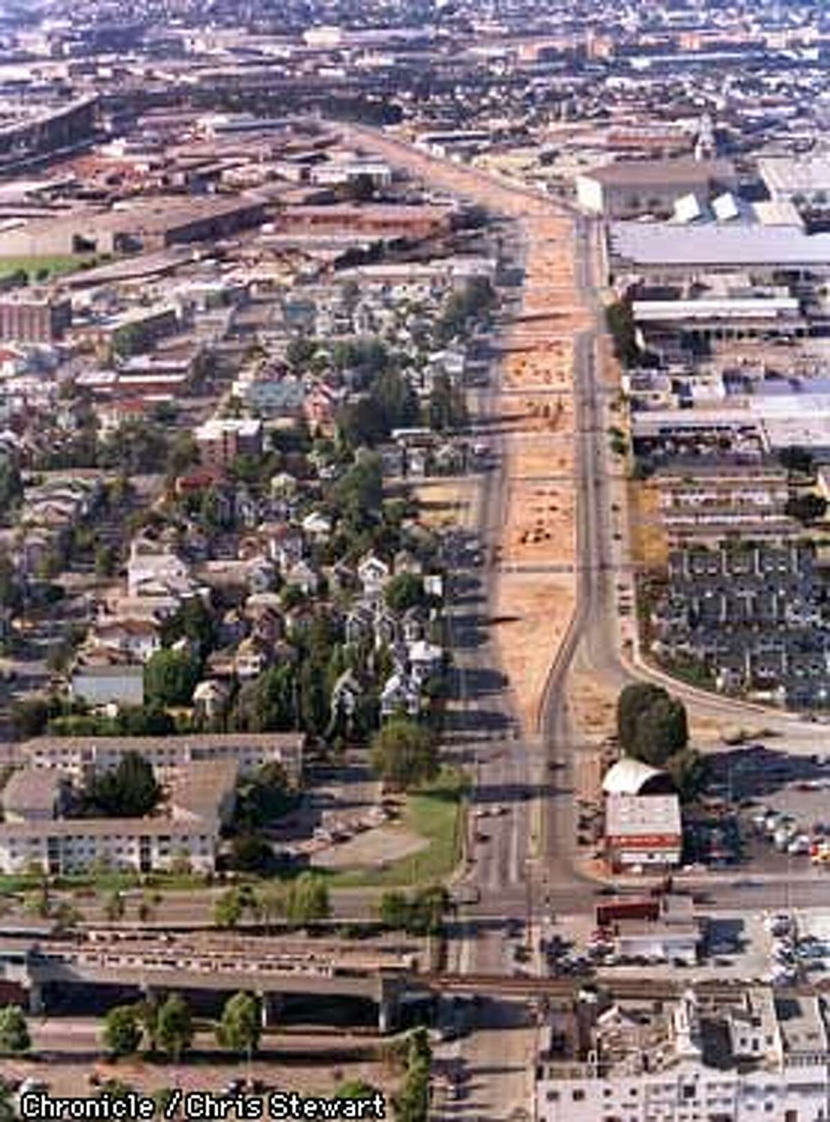 Long after the Cypress freeway structure in West Oakland was torn down following its destruction in the 1989 Loma Prieta earthquake, the ground level Mandela Parkway which replaced the Cypress remains a brown scar of unlandscaped dirt. A major portion of the rebuilt Cypress freeway should open within a month. SAN FRANCISCO CHRONICLE PHOTO BY CHRIS STEWART