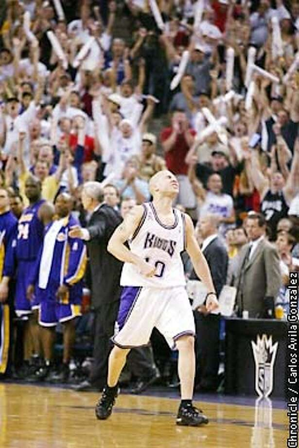The Kings's Michael Bibby, celebrates his game-winning three-point shot in the final seconds of play against the Lakers. The Sacramento Kings played the Los Angeles Lakers in Game 5 of the NBA Western Conference Finals at Arco Arena in Sacramento, Ca., on Tuesday, May 28, 2002.  (PHOTO BY CARLOS AVILA GONZALEZ/THE SAN FRANCISCO CHRONICLE) Photo: CARLOS AVILA GONZALEZ