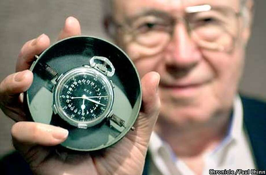 Theodore Van Kirk, the flight navigator aboard the Enola Gay, held up his navigator's master clock carried by him during the atomic bomb mission over Hiroshima. Butterfield's estimates the clock's value between $15,000 and $25,000.  PAUL CHINN/S.F. CHRONICLE Photo: PAUL CHINN