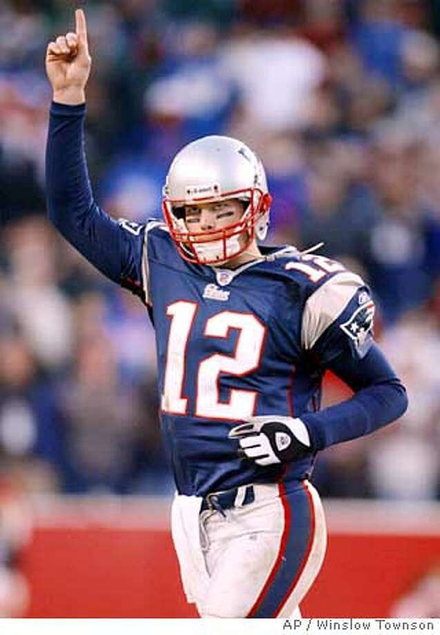 New England Patriots quarterback Tom Brady acknowledges the applause of the crowd as he is taken out of the game against the Buffalo Bills in the fourth quarter at Gillette Stadium Saturday, Dec. 27, 2003 in Foxboro, Mass. The Patriots beat the Bills 31-0. (AP Photo/Winslow Townson) QB Tom Brady is the NFL's Most Valuable Player because he is the glue that holds the New England Patriots together. Photo: WINSLOW TOWNSON