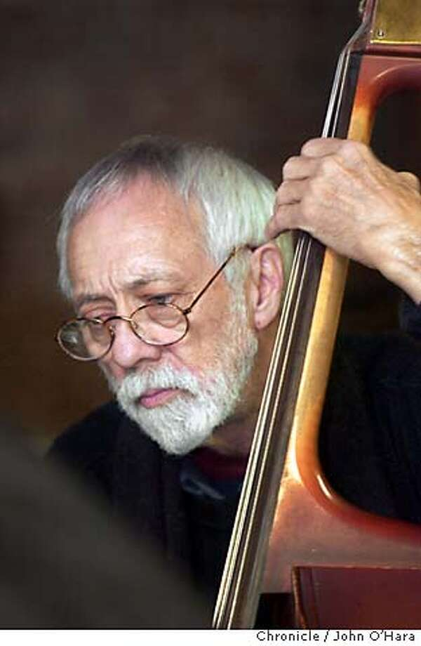 SCOTT04 Don Bennett, bassist for the Cartoon Jazz band, rehearses with the band. BY JOHN O'HARA Photo: JOHN O'HARA