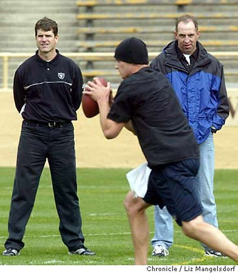 Scouts Jim Harbaugh, left, with the Oakland Raiders, and Jeep Chryst, with the Arizona Cardinals, watch Kyle Boller practice at UC Berkeley Memorial Statium Thursday Morning. Photo by Liz Mangelsdorf Photo: Liz Mangelsdorf