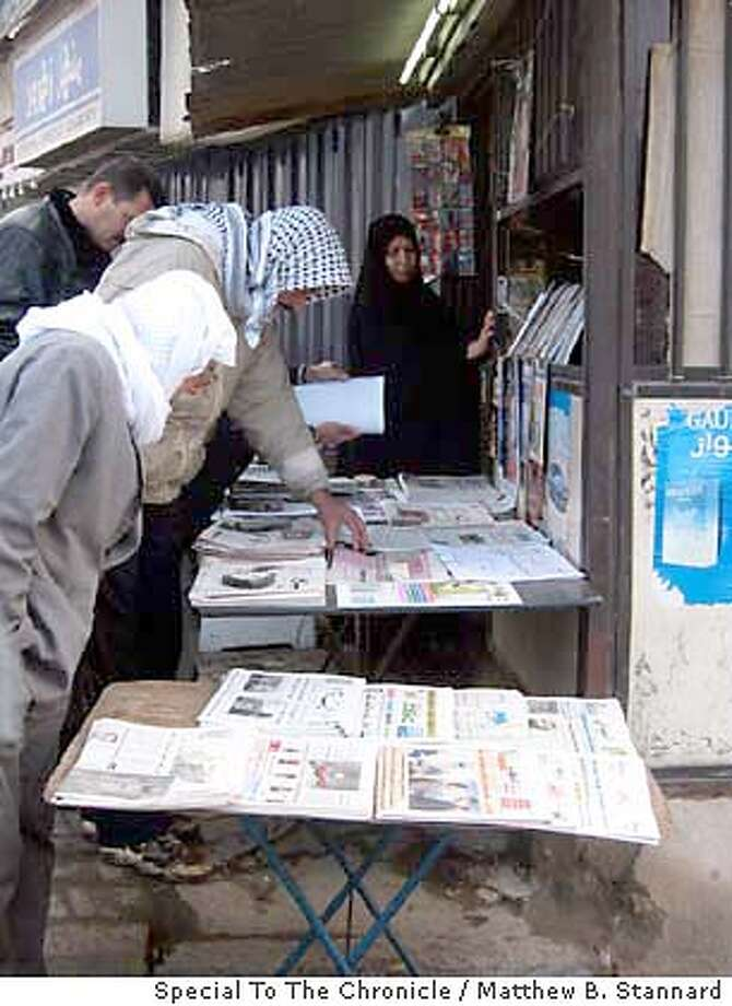 for iraq-paper; Iraqis peruse newspapers at a Baghdad news vendor Matthew B. Stannard, / Special To The Chronicle Photo: Matthew B. Stannard