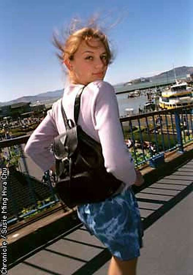 Sarah Williams, 14, a finalist in the Cover Girl model search for teens, struts a Guess Bellpack at Pier 39. Chronicle Photo by SUSIE MING HWA CHU. Photo: SUSIE MING HWA CHU