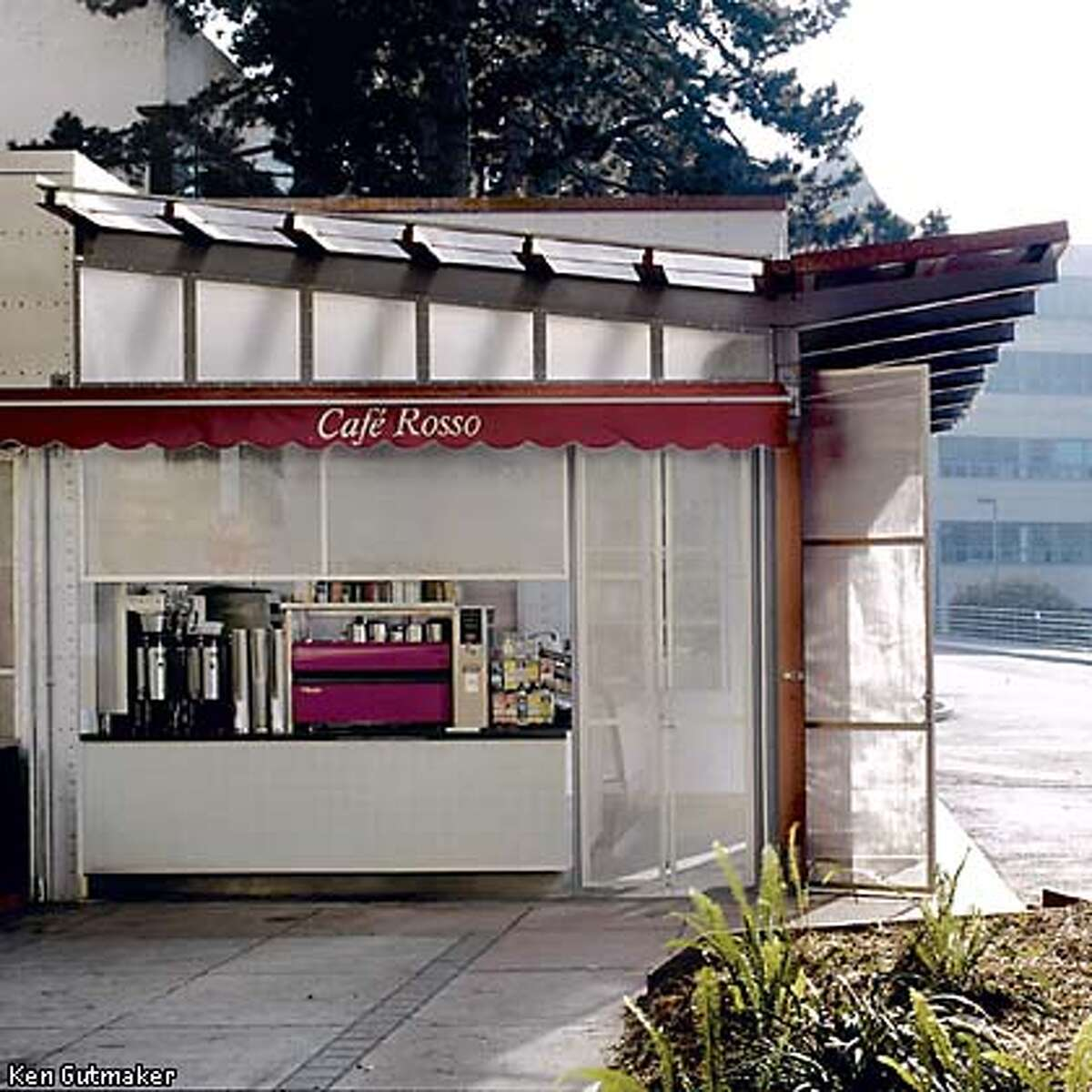 Red signage advertises the cafe name discreetly and the glass, tile and steel details echo dorm buildings nearby. Photo by Ken Gutmaker