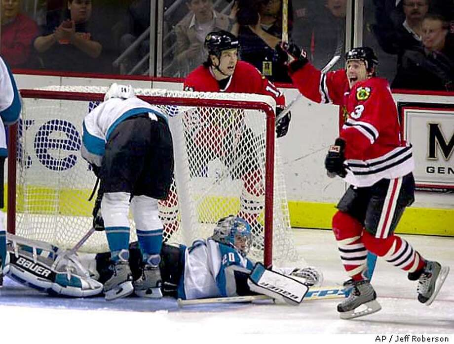 Chicago Blackhawks' Brett McLean, right, celebrates along with teammate Tuomo Ruutu, behind goal, of Finland after scoring on San Jose goalie Evgeni Nabokov (20) of Kazakhstan during the third period Friday, Jan. 2, 2004 in Chicago. The Blackhawks won the game 2-1. (AP Photo/Jeff Roberson) Photo: JEFF ROBERSON