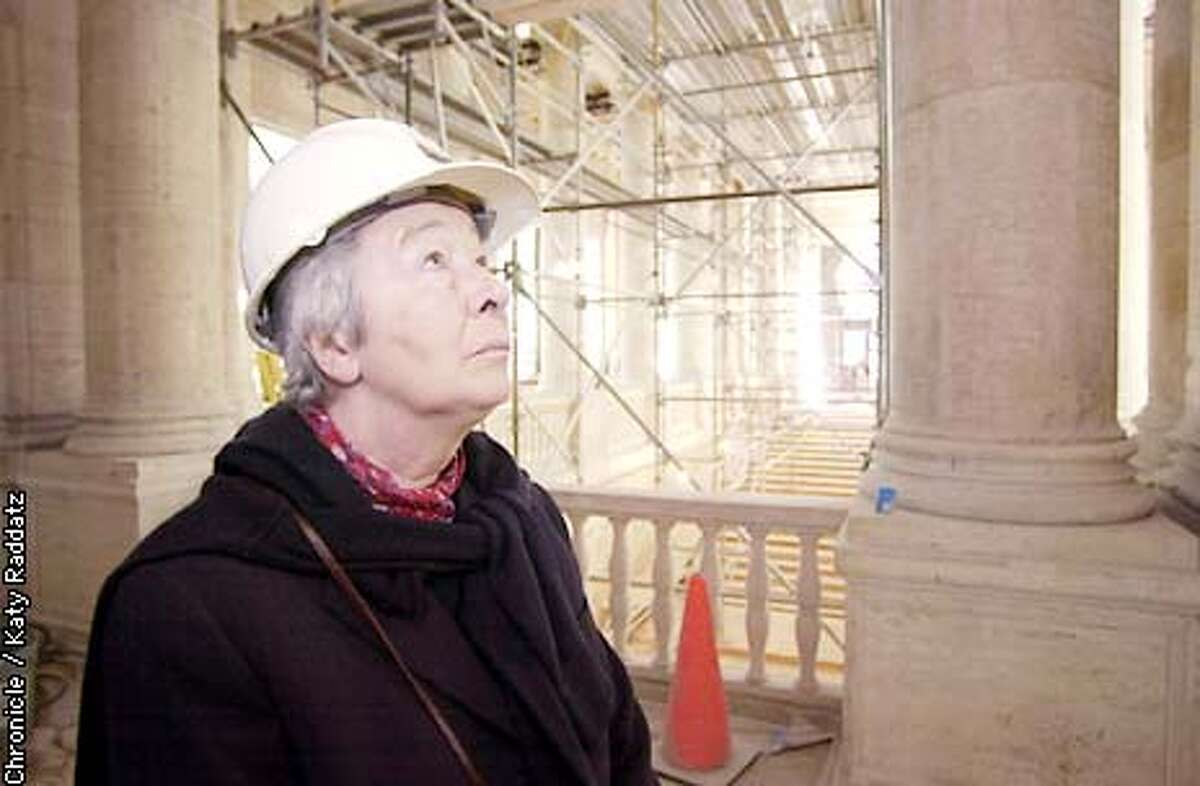 PHOTO BY KATY RADDATZ--THE CHRONICLE New Asian Art Museum tour. SHOWN: architect Gae Aulenti casts a baleful eye on the pigeons who sully the building with their droppings. Behind her are the big columns and the main stairway.