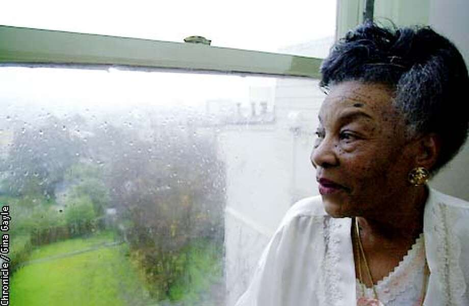 Amelia Gibson looks out of her window that has a nice view. Since her stroke has made it difficult for her to use the stairs to her apaprtment she likes to look out of this window. Photo by Gina Gayle/The SF Chronicle. Photo: GINA GAYLE