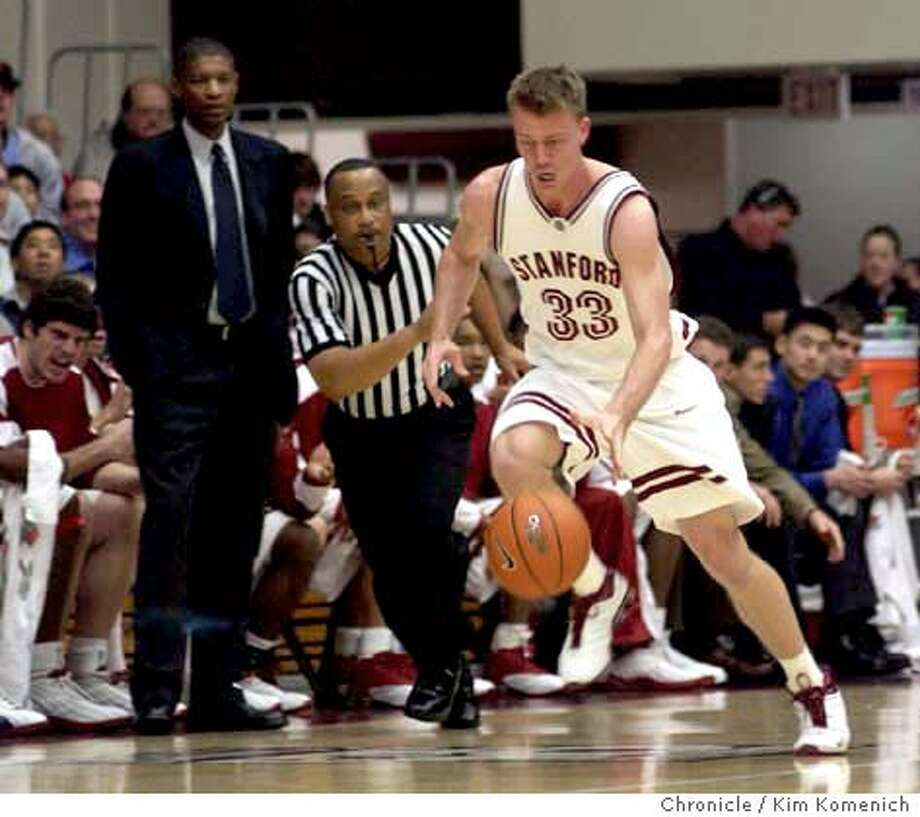 Stanford vs. Washington State Men's basketball at Maples Pavilion. Matt Lottich drives past Assistant Coach Tony Fuller, left, who replaced Mike Montgomery as Stanford's coach for the Washington State game. Ref is not identified. (seeking confirmation on ref's name.) KIM KOMENICH/The Chronicle Photo: KIM KOMENICH