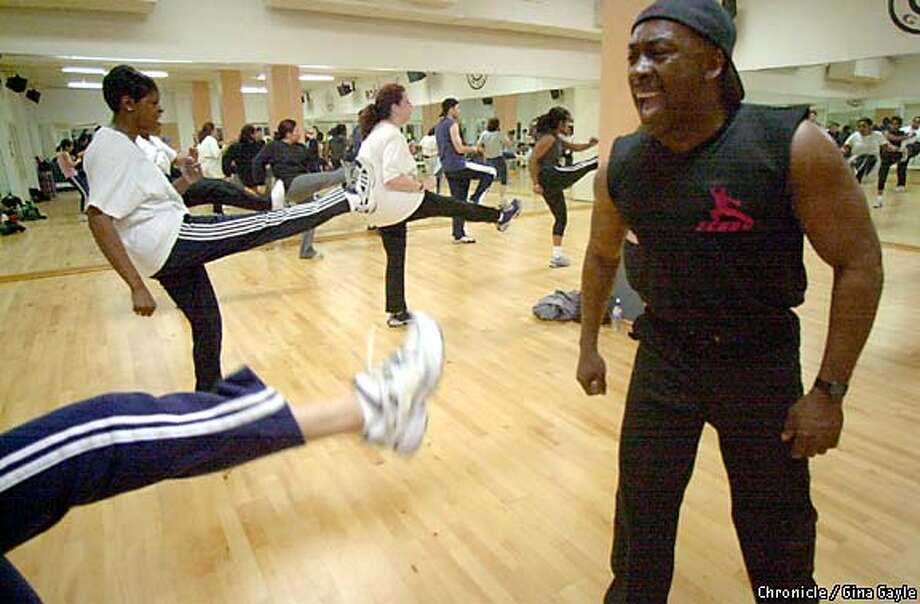 "Getting their kicks: Ken McCullum teaches a final Kenbo kickboxing class at Gold's Gym at Lake Merritt in Oakland. He began teaching ""aerobic self-defense"" in 1982, but the concept didn't really take off until Taebo popularized it. Chronicle photo by Gina Gayle"
