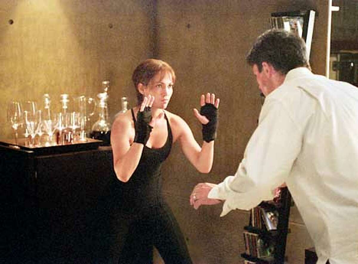 C162-15A Photo by: Van Redin (L. to R.) Slim (Jennifer Lopez) sets out to prove to Mitch (Billy Campbell) that she�s had Enough in the upcoming thriller by Columbia Pictures. (HANDOUT PHOTO)