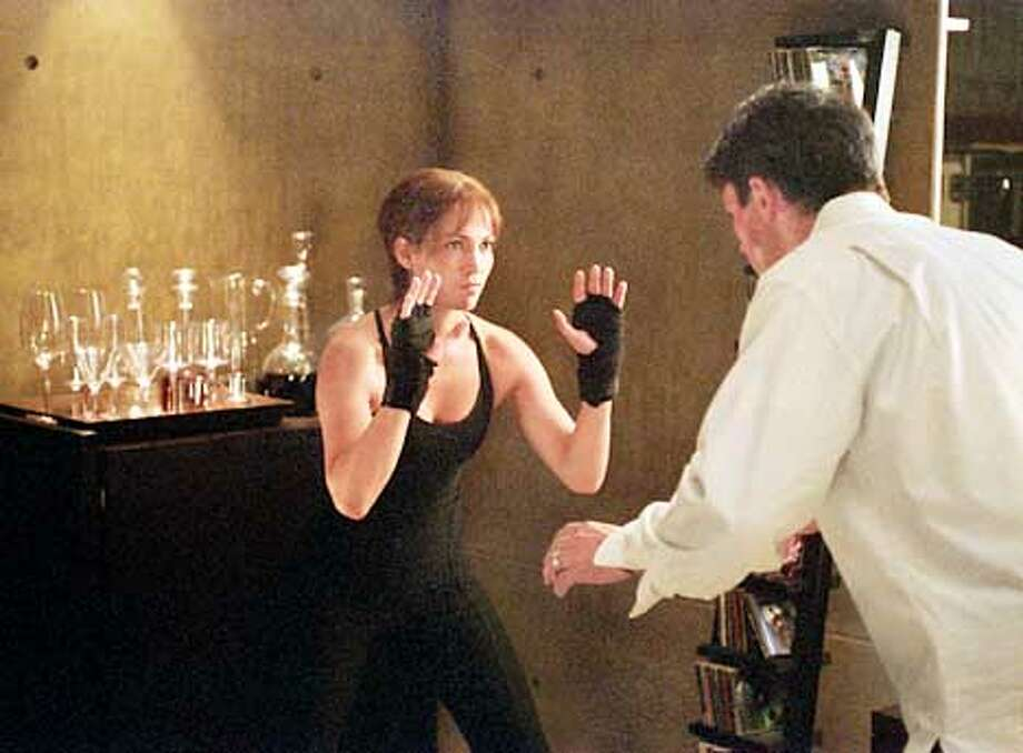 C162-15A Photo by: Van Redin (L. to R.) Slim (Jennifer Lopez) sets out to prove to Mitch (Billy Campbell) that she�s had Enough in the upcoming thriller by Columbia Pictures. (HANDOUT PHOTO) Photo: HANDOUT