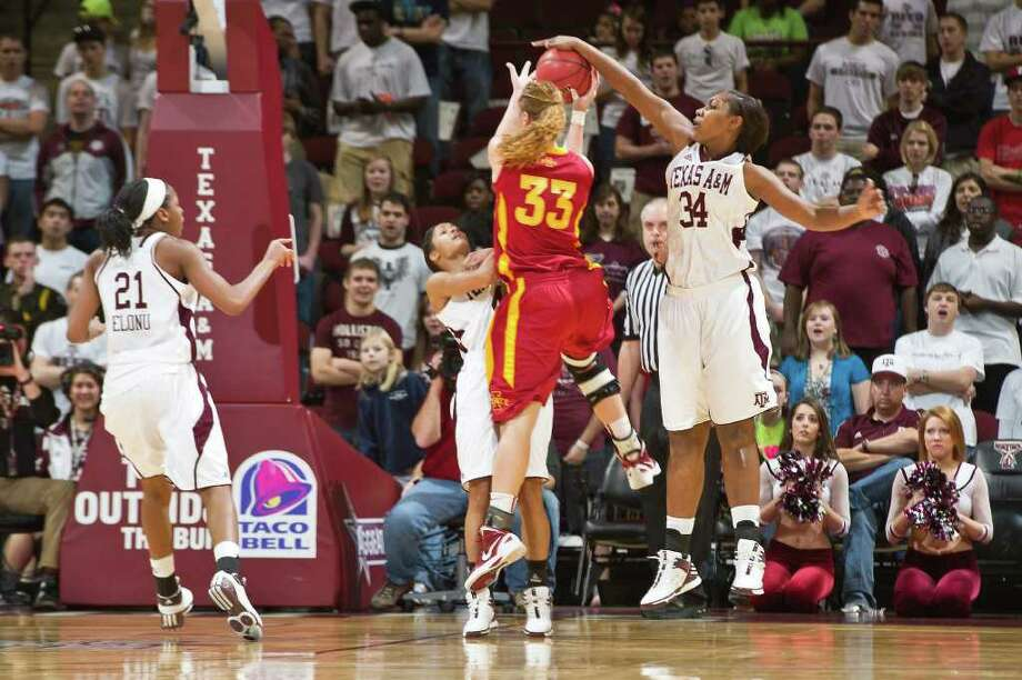 Texas A&M's Karla Gilbert (34) snuffs out a shot by Iowa State's Chelsea Poppens. Photo: Glen Johnson