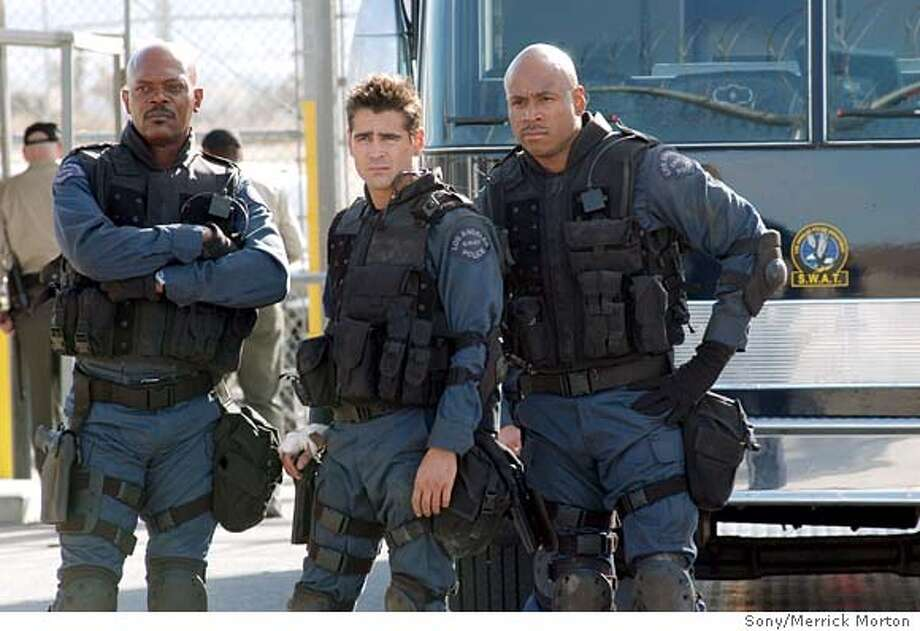 SWAT08-288 For SWAT08, Datebook ; (l to r) Samuel L. Jackson, Colin Farrell and James Todd Smith (aka L.L. Cool J) portray elite S.W.A.T. team members on a high-risk assignment in Columbia Pictures' action thriller, S.W.A.T. ; photo credit: Merrick Morton ; on 12/9/02 in . Merrick Morton / Sony Pictures MANDATORY CREDIT FOR PHOTOG AND SF CHRONICLE/ -MAGS OUT Photo: Merrick Morton
