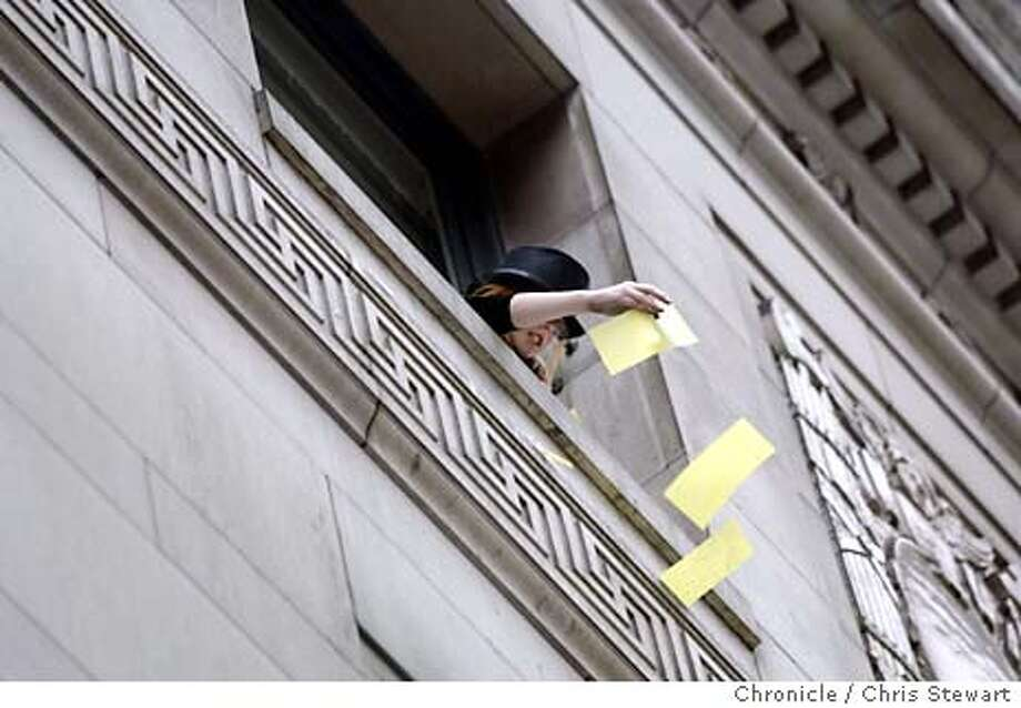 calendars045_cs.jpg  Event on 12/31/03 in San Francisco. An office worker tosses her 2003 calendar out the window of a building at the corner of California and Sansome. This is an annual, hoary old tradition of office workers throwing their 2003 calendars out the windows of the Financial District. Chris Stewart / The Chronicle Photo: Chris Stewart