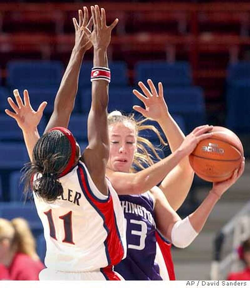 28 ua women-washington--Arizona's Dee-Dee Wheeler (cq-Dee-Dee Wheeler) applies defense to Washington's #13 Giuliana Mendiola (Giuliana Mendiola, cq) in the first half Saturday, Dec. 27, 2003 in McKale in Tucson, AZ during the Pac-10 season opener. Wheeler had 19 points in the game. Photo by David Sanders//Arizona Daily Star. No mags, Mandatory credit. #104393. Photo: David Sanders