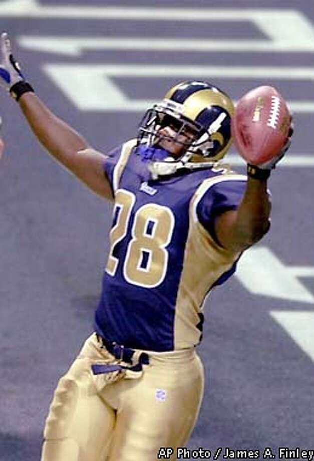 St. Louis Rams' Marshall Faulk celebrates after scoring on a 1-yard run in the first quarter against the Indianapolis Colts in St. Louis, Sunday, Dec. 30, 2001. (AP Photo/James A. Finley) Photo: JAMES A. FINLEY