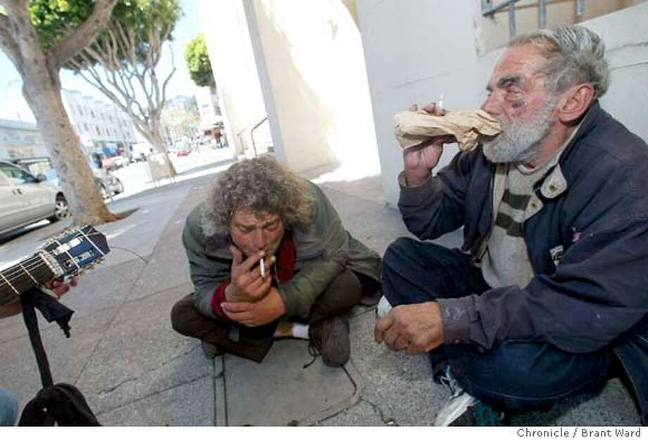 homeless5034_bw.jpg In San Francisco's North Beach area, just off Columbus Avenue, Lou Dinarde, right, polishes off his pint of vodka for the morning with an unidentified friend. Dinarde is poster boy for homeless enablement. BRANT WARD / The Chronicle Lou Dinarde (right) polishes off his morning pint of vodka with an unidentified friend in North Beach just off Columbus Avenue. Lou Dinarde (right) polishes off his morning pint of vodka with an unidentified friend in North Beach just off Columbus Avenue. Photo: BRANT WARD