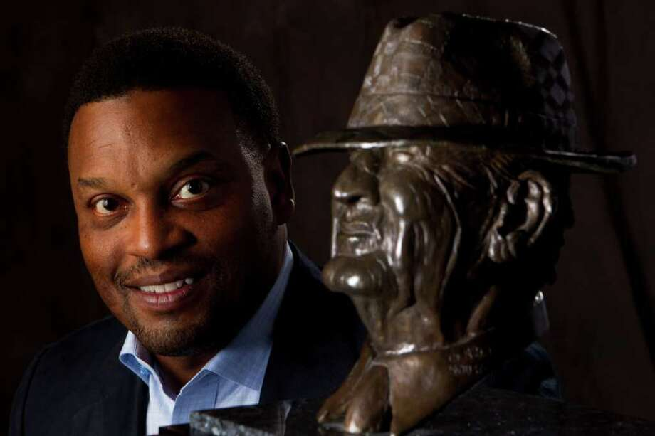 "Texas A&M head coach Kevin Sumlin poses for a portrait with the Paul ""Bear"" Bryant Award Thursday, Jan. 19, 2012, in Houston. Sumlin, the former University of Houston head coach, is a finalist for the 2011 college football coach of the year. ( Brett Coomer / Houston Chronicle ) Photo: Brett Coomer / © 2012 Houston Chronicle"