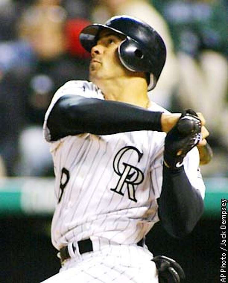 Colorado Rockies' Bobby Estalella watches a three-run home run fly into the stands off San Francisco Giants starting pitcher Russ Ortiz during the fourth inning Friday, May 24, 2002, in Denver. (AP Photo/Jack Dempsey) Photo: JACK DEMPSEY