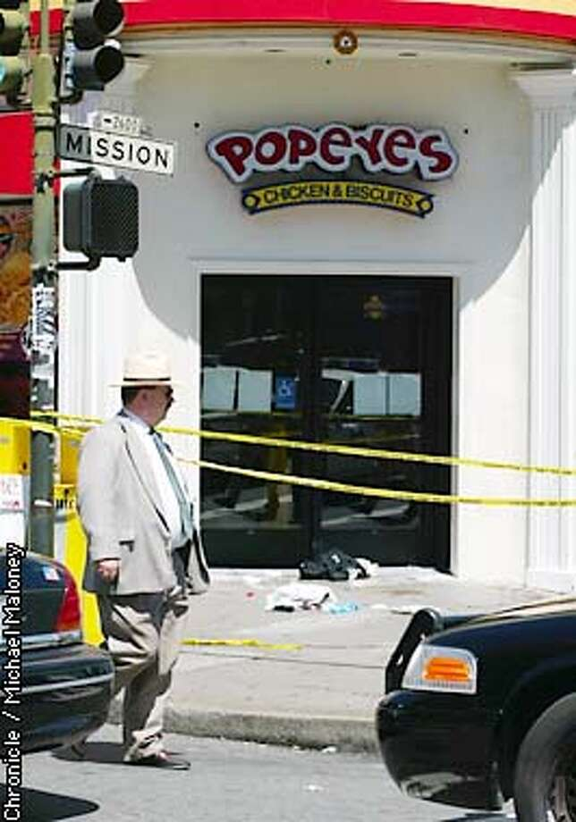 SFPD Lt Henry Hunter walks in front of the crime scene at Mission and 22nd Streets in SF where at least 4 people were hospitalized.  CHRONICLE PHOTO BY MICHAEL MALONEY Photo: MICHAEL MALONEY