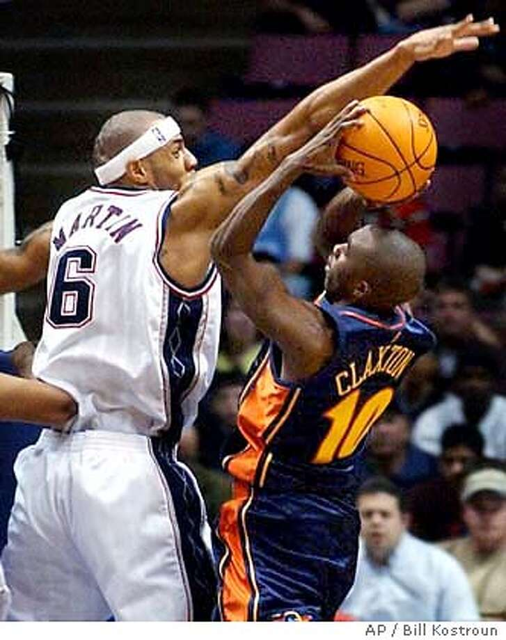 """Golden State Warriors' Craig """"Speedy"""" Claxton, right, attempts to shoot over New Jersey Nets' Kenyon Martin during the first quarter Wednesday night, Dec. 31, 2003, in East Rutherford, N.J. (AP Photo/Bill Kostroun) Photo: BILL KOSTROUN"""