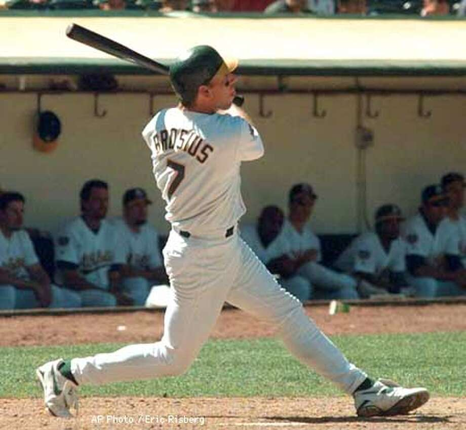 Oakland Athletics' Scott Brosius follows his game-winning home run off San Diego Padres pitcher Rich Batchelor during the eighth inning of their game in Oakland, Calif., Tuesday July 1, 1997. The A's won the game, 8-6. (AP Photo/Eric Risberg) Photo: ERIC RISBERG