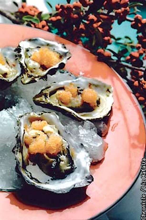 Oysters with granita. (BY LIZ HAFALIA/THE SAN FRANCISCO CHRONICLE) Photo: LIZ HAFALIA