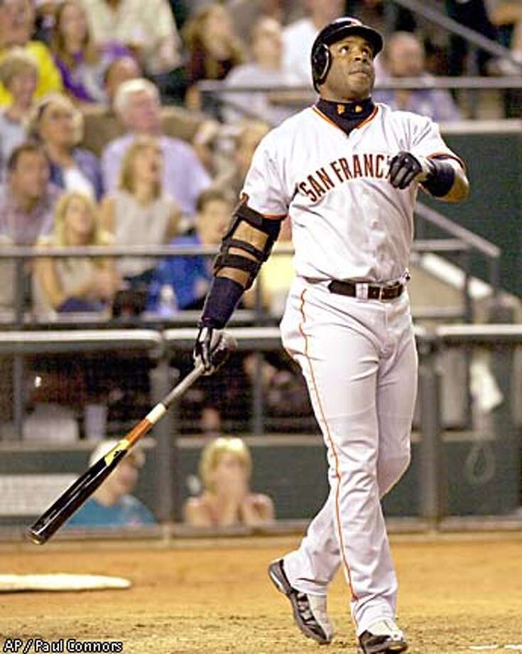 Barry Bonds watches his 583rd career home run, a towering shot that hit high on the foul pole in right. Associated Press photo by Paul Connors