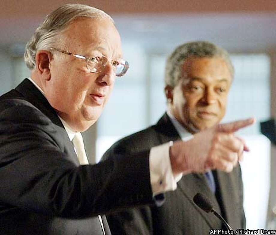 David H. Komansky, left, chariman and CEO of Merrill Lynch & Co., and Stan O'Neal, the company's president and COO, address a New York news conference, Tuesday May 21, 2002, where they announced that Merrill Lynch & Co. has agreed to pay $100 million to settle allegations that the firm's analysts misled investors with their stock ratings so the company could win lucrative investment banking fees. (AP Photo/Richard Drew) Photo: RICHARD DREW