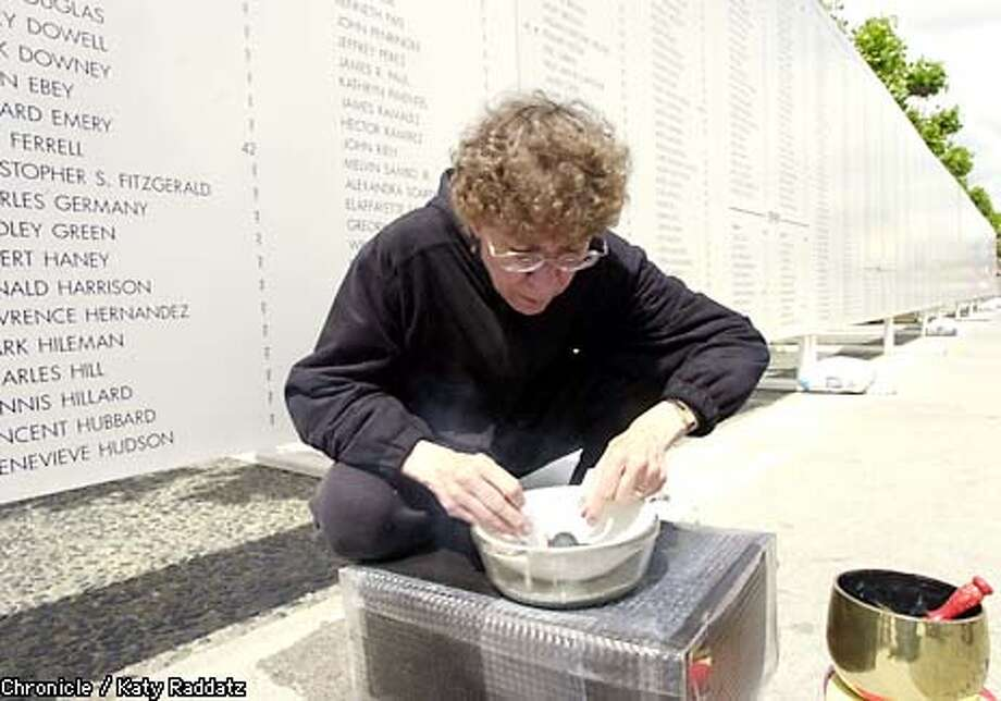 PHOTO BY KATY RADDATZ--THE CHRONICLE  Memorial for homeless people who've died on the streets. An 85-foot memorial wall bears approximately 2,000 names of homeless deaths of the past 15 years. SHOWN: lighting incense before service is Sister Bernie Galvin, Executive Director of Religious Witness with Homeless People Photo: KATY RADDATZ
