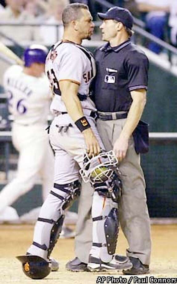 San Francisco Giants catcher Benito Santiago, left, butts into homeplate umpire Bill Hohn, right, after Hohn ejected Santiago for disputing a call against the Arizona Diamondbacks in the seventh inning Tuesday, May 21, 2002, in Phoenix.(AP Photo/Paul Connors) Photo: PAUL CONNORS