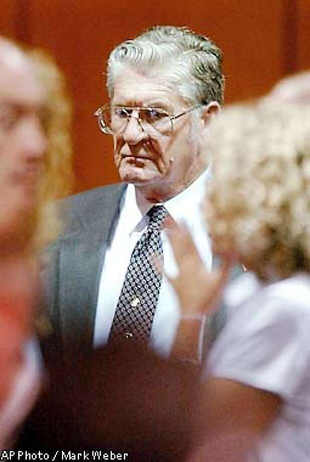 Murder defendant Bobby Frank Cherry leaves the courtroom, during a break in his trial at the Jefferson County Criminal Justice Center in Birmingham, Ala., Tuesday, May 21, 2002. Cherry is on trial for the racist that killed four young black girls in 1963. (AP Photo/Birmingham Post-Herald, Mark Weber) Photo: MARK WEBER
