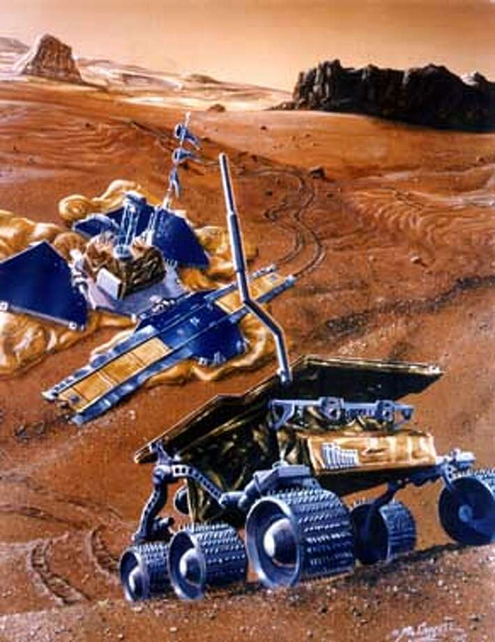 WINDRIVER4/C/30JUN97/BU/HO--This artist's rendering shows the Mars Pathfinder lander and rover in operation on the Martian surface in July 1997. Once on the surface, the lander petals will deploy to expose three solar panels for power. The lander camera will survey the surroundings and the rover will be positioned for deployment to the surface. The lander will transmit engineering and science data directly to Earth at a few thousand bits per second.