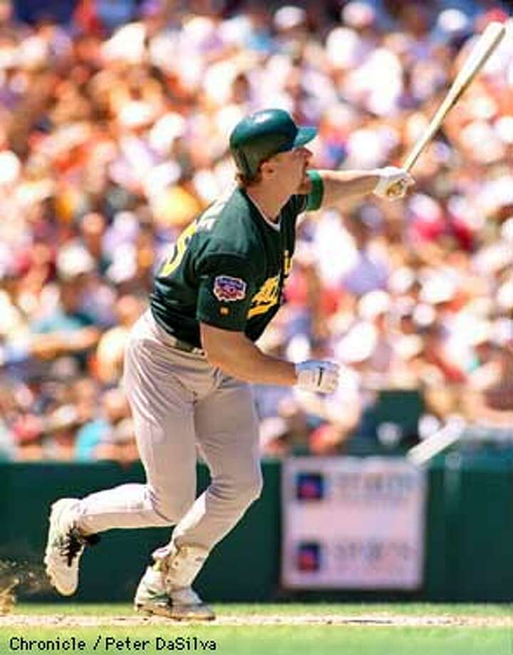 A's Mark McGwire watches his three run homer make its way over the center field fence in the 5th inning against the Giants during their first InterLeague Game. Chronicle Photo By: Peter DaSilva Photo: Peter DaSilva